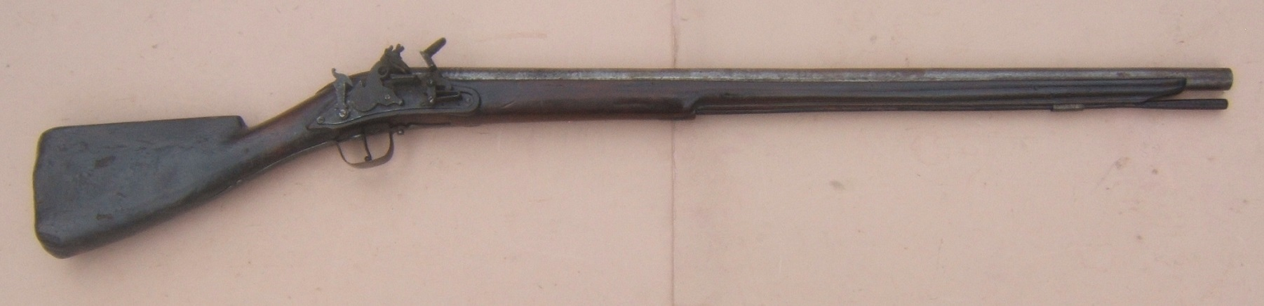 A VERY RARE ENGLISH/EARLY COLONIAL AMERICAN PERIOD ENGLISH DOGLOCK MUSKET, ca. 1650 view 1