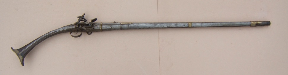 "A FINE QUALITY SMALL-SIZE ALBANIAN ""ALL-METAL"" MIQUELET LONG-GUN, ca. 1820 view 1"