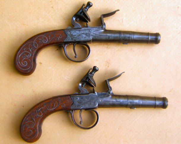 A FINE PAIR OF REVOLUTIONARY WAR PERIOD SILVER-WIRE-INLAY ENGLISH FLINTLOCK TURN-OFF PISTOLS, ca. 1775 view 1