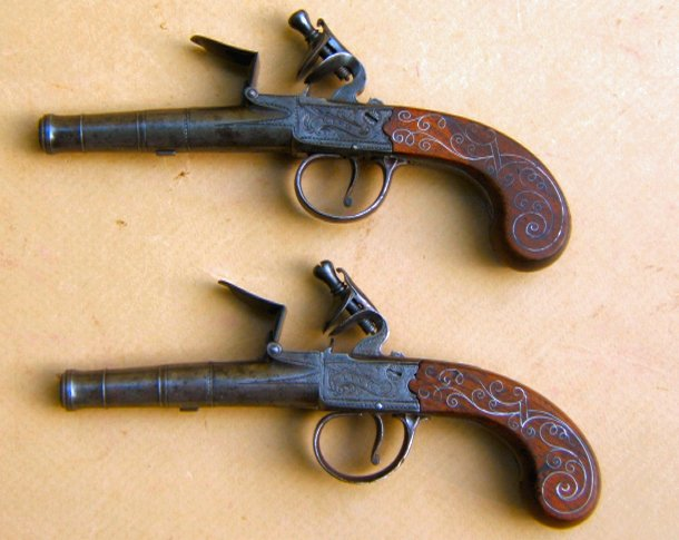 A FINE PAIR OF REVOLUTIONARY WAR PERIOD SILVER-WIRE-INLAY ENGLISH FLINTLOCK TURN-OFF PISTOLS, ca. 1775 view 2