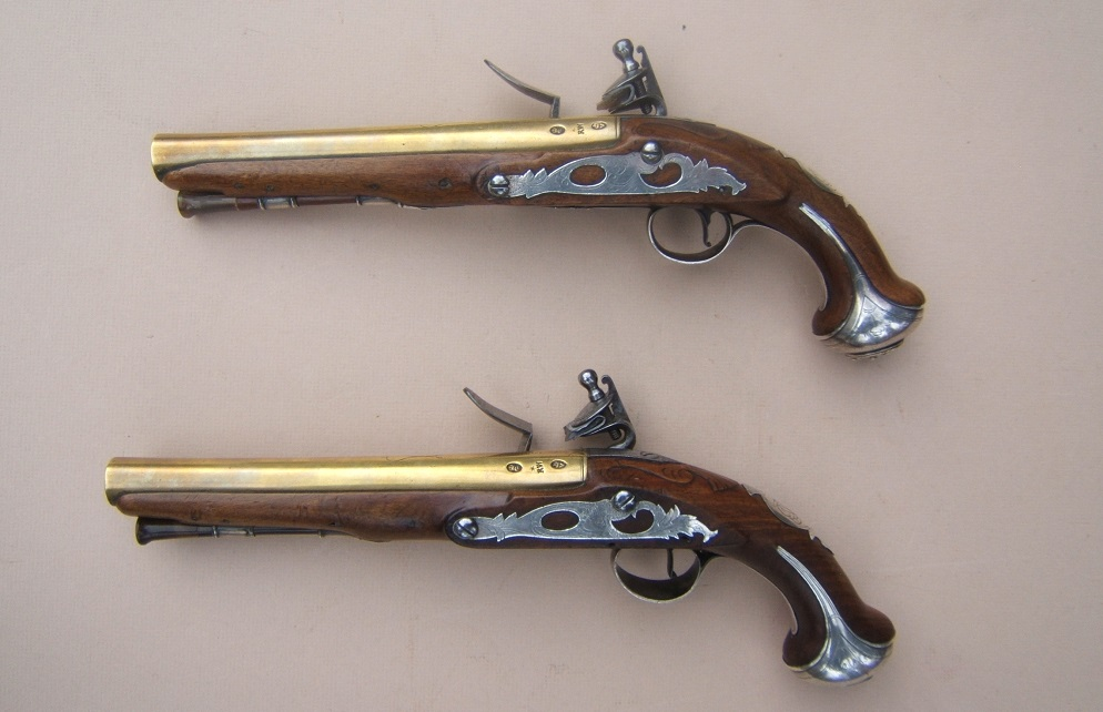 "A FINE PAIR OF FRENCH & INDIAN/AMERICAN REVOLUTIONARY WAR PERIOD ""ENGLISH"" SILVER MOUNTED BRASS BARREL FLINTLOCK OFFICER'S PISTOLS, by"