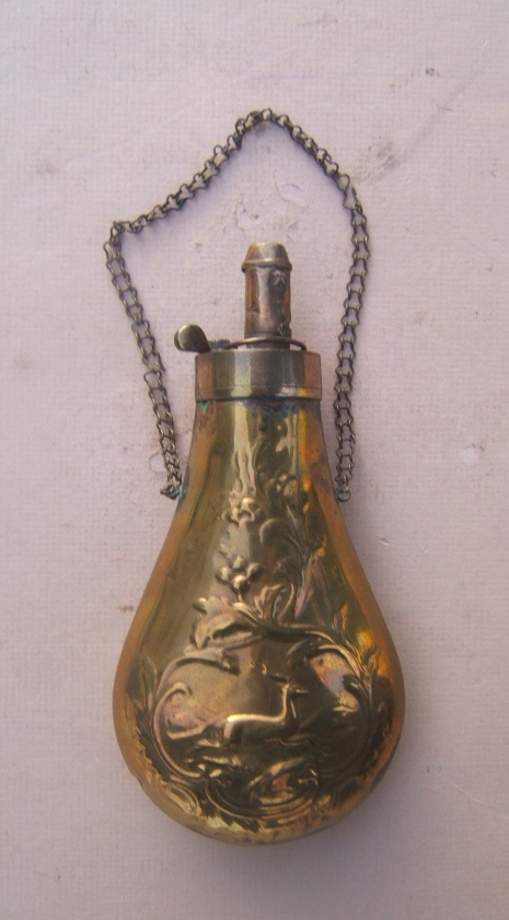 A VERY GOOD EMBOSSED MID-19TH CENTURY BRASS POWDER FLASK, ca. 1860 view 1