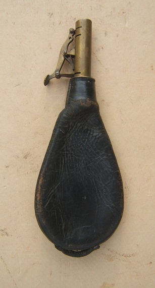 A VERY GOOD QUALITY MID 19TH CENTURY ENGLISH LEATHER SHOT FLASK, ca. 1850s view 1