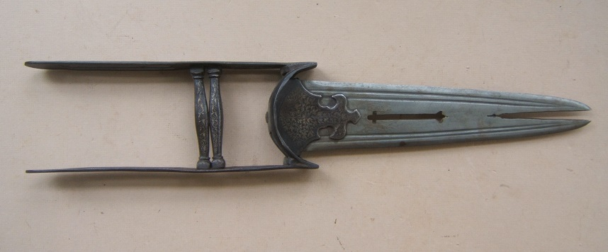 A FINE LATE 19th CENTURY SILVER-DAMASCENED SPLIT-BLADE INDIAN KATAR, ca. 1880 view 1