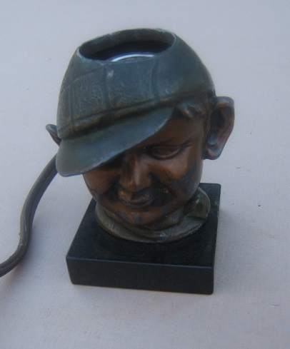 A POST WW II ERA HOBO'S HEAD ELECTRIC CIGAR LIGHTER, ca. 1950 view1