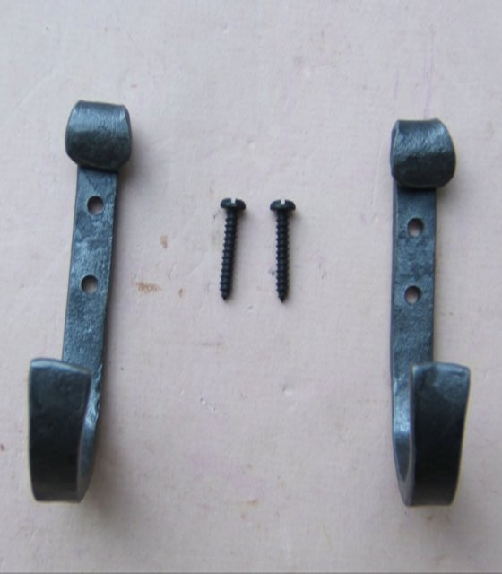 LARGE PAIR(S) OF HAND FORGED WROUGHT IRON GUN HOOKS & SCREWS view1